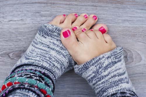 Female-pink-pedicure-on lovely feet