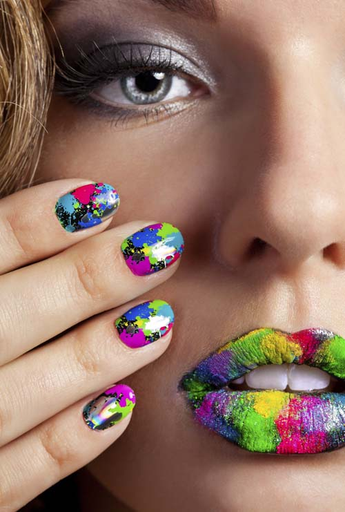 Half-face-of-attractive-girl-with-beautiful- hot cute sexy-multicolor-holographic-Minx-nails-and-bright-colorful-make-up