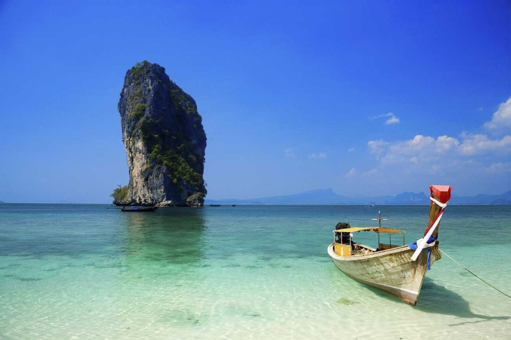 Boat anchored at beach Ko Poda in background Laem Phra Nang Railay Krabi Thailand