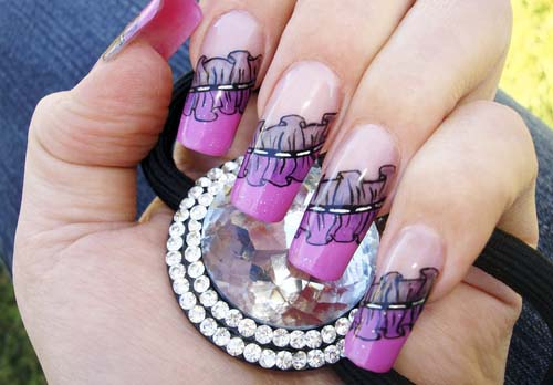 female-hand- hot cute sexy with-stunning-frills-nail-art-design-manicure-holding-a-silver-hair-clip