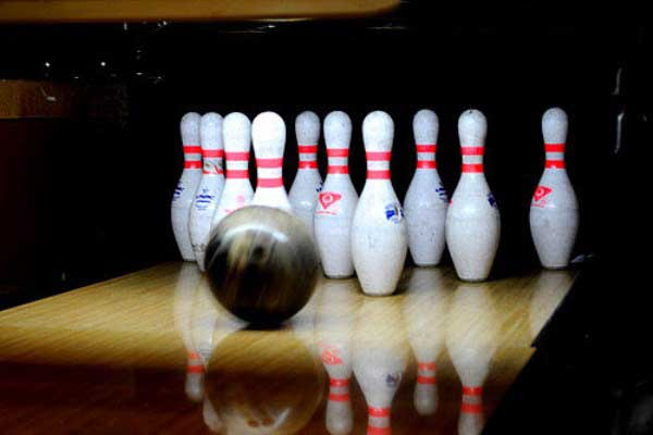 Bowling ball hit pins images