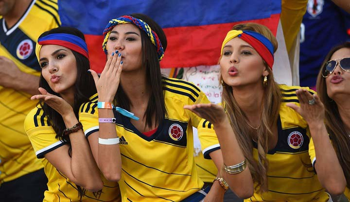 Gorgeous fans showing support to their teams in FIFA 2014