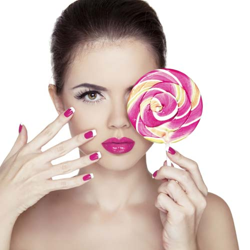 Beauty-Girl-Portrait-holding-Colorful-lollipop.pink nail polished