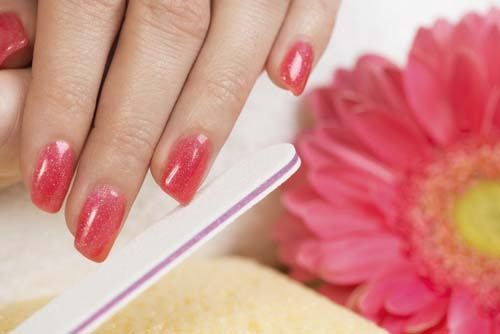 sexy Manicure-treatment.-Close-up-of-female-hands-having-manicure.-pink-nail-polish-on-fingernails